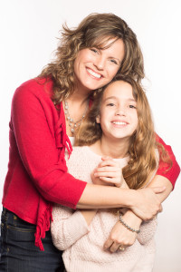 I took my daughter to help me on this photo shoot...and the cameraman added a few extra shots of us together for the fun of it. See the sparkle in her mother's eyes?